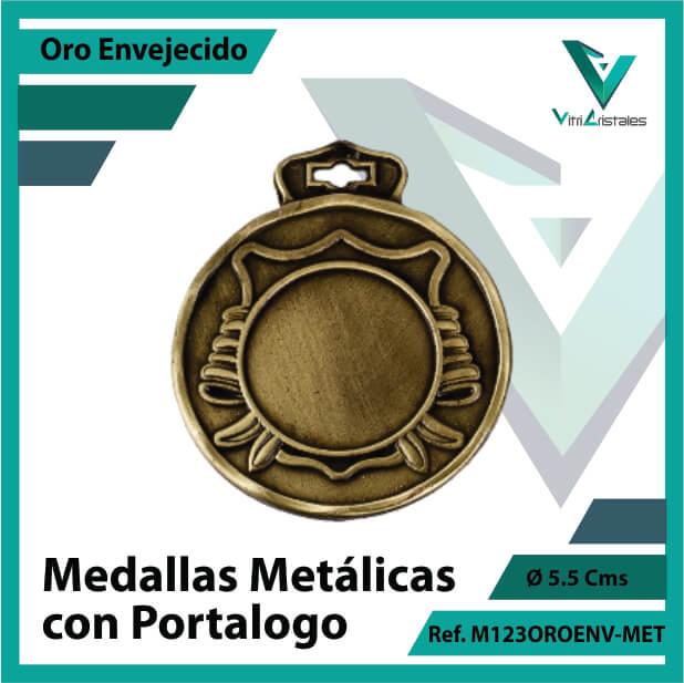 medallas en oro metalicas con portalogo ref m123oroenv-met
